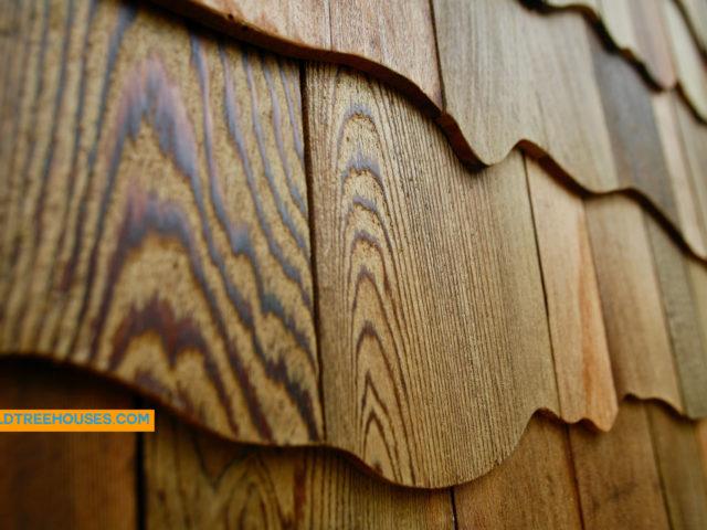 WNC treehouse builder: Siding art to mimic bark