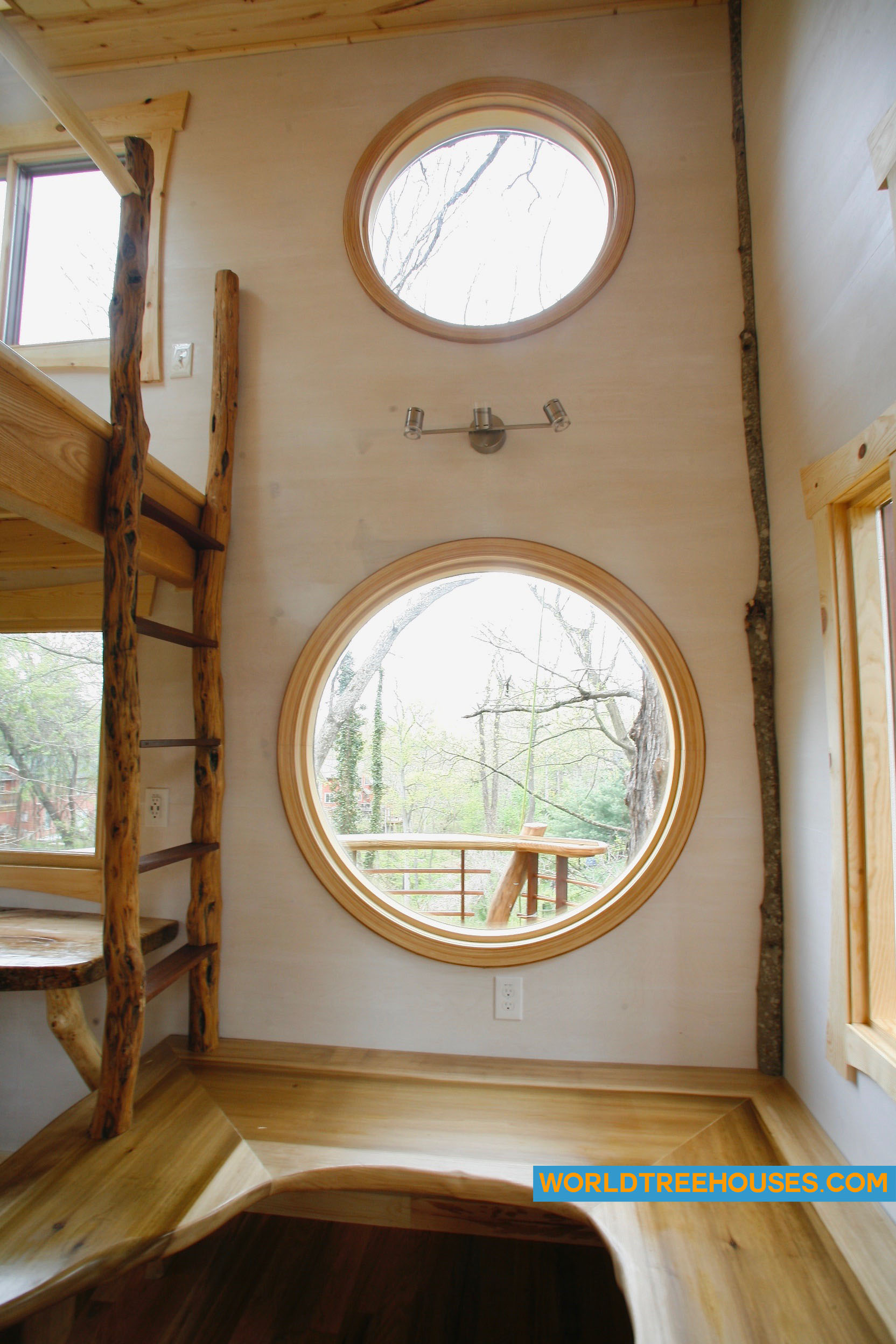 WNC tree house builders: Circular interior windows