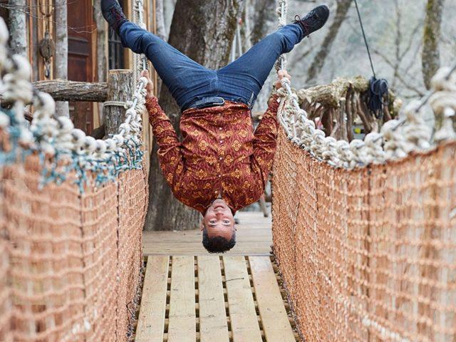 NC treehouse builders : Panthertown: Owner, Adam Laufer, on suspension bridge