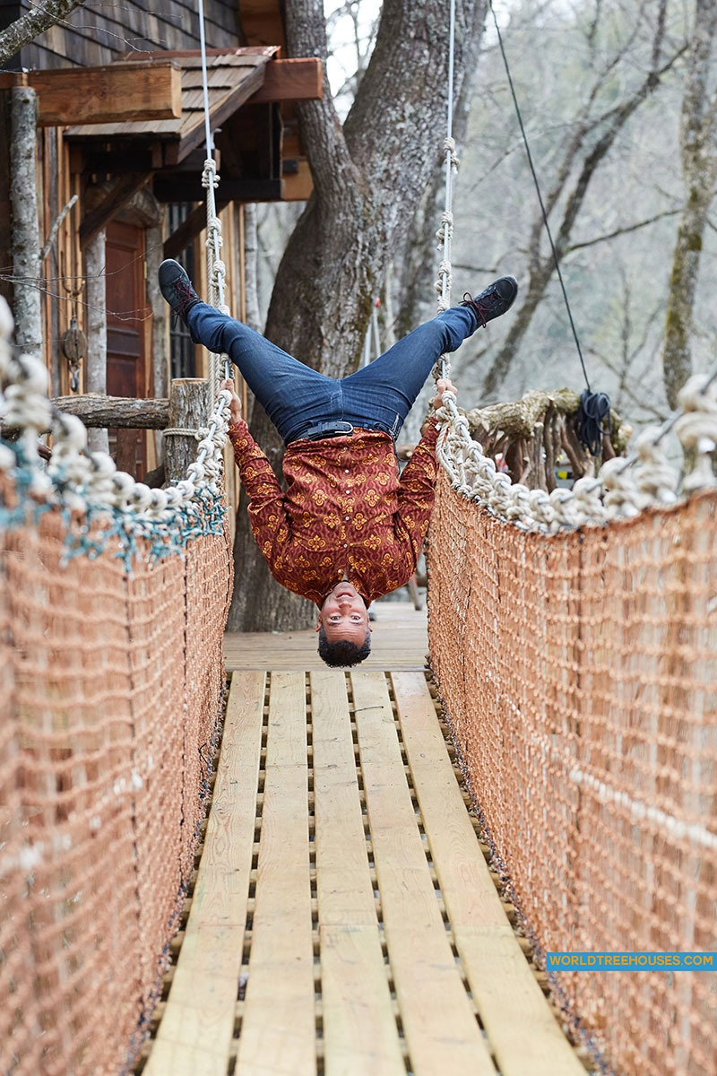 NC treehouse builders : Panthertown: Owner, Adam Laufer, on suspension bridge