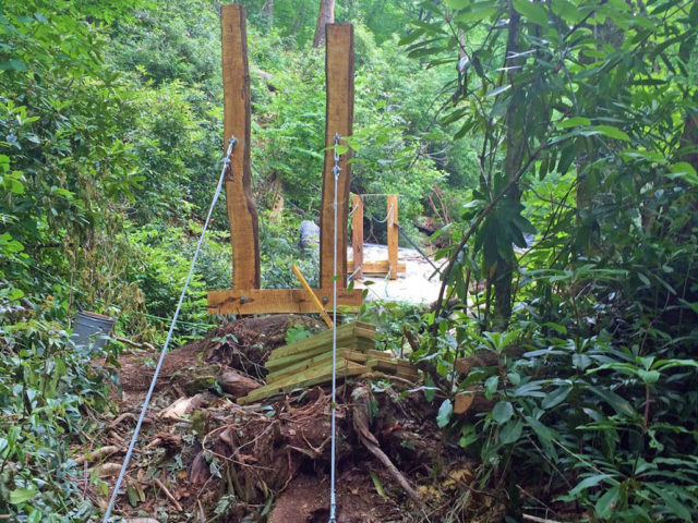 WNC TREE HOUSE BUILDERS : Panthertown swimming hole access: Adding the guy wires that support the bridge