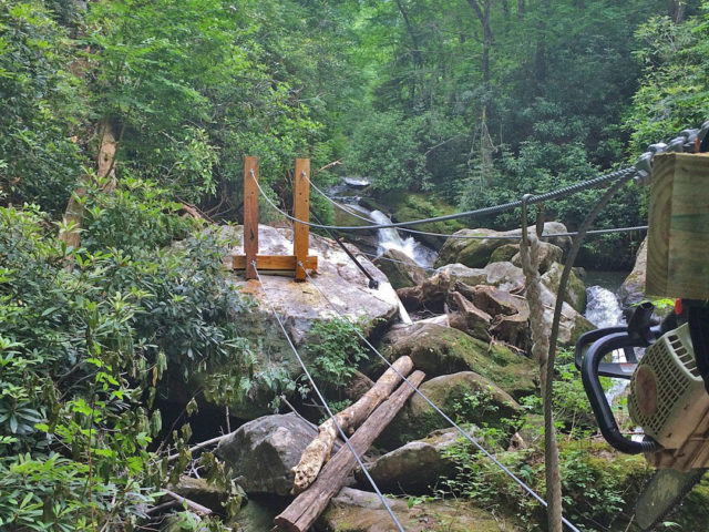 NC tree house builders : Panthertown swimming hole access: The bridge exit posts are up!