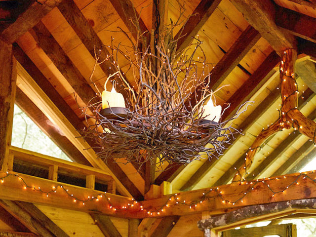 Asheville Treehouse Builder: Panthertown Treehouse: All lit up with hanging twig chandelier.